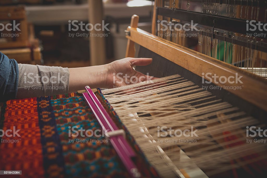 Hand Weaving on a Loom stock photo