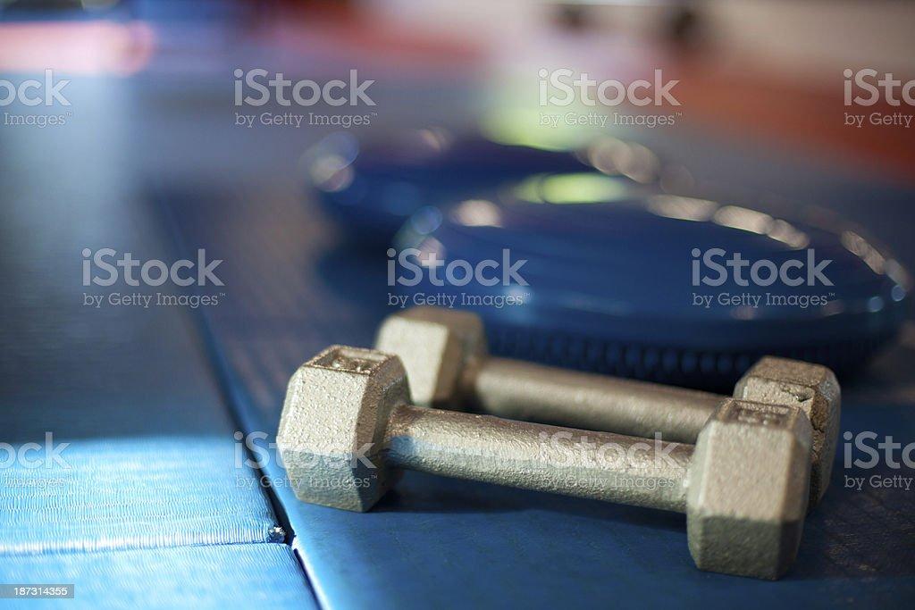 Hand weights on gym mat - horizontal stock photo
