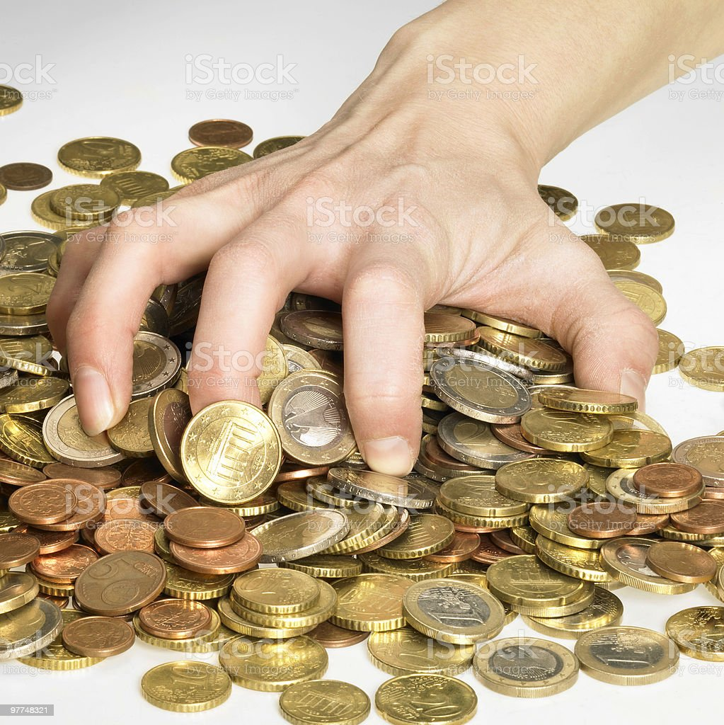 hand while gathering euro coins royalty-free stock photo