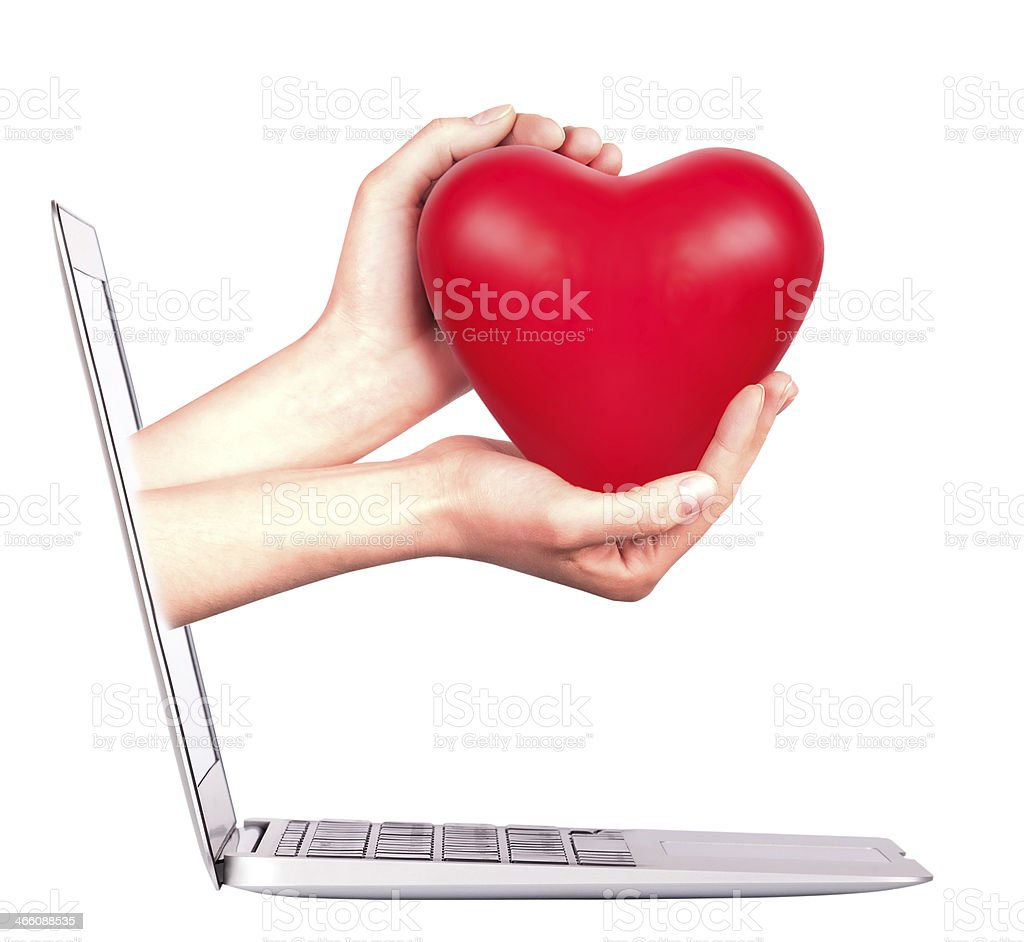 hand with a heart - gift and laptop stock photo