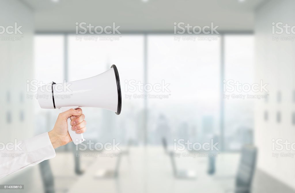 Hand with a loudspeaker stock photo
