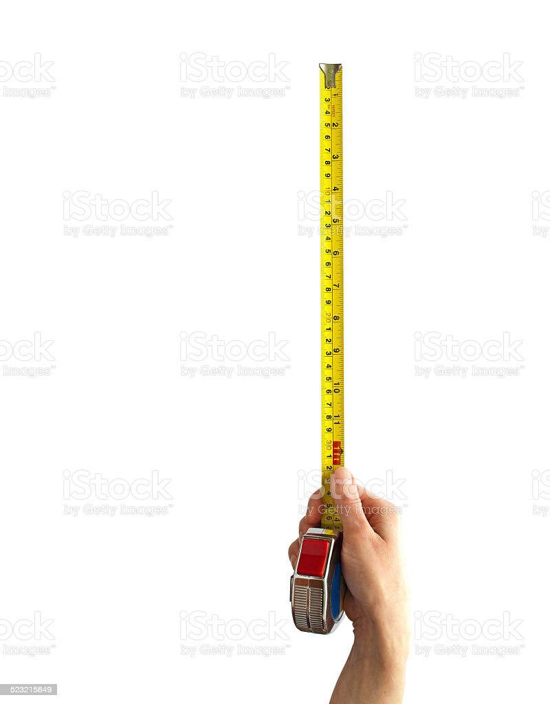 Hand with a measuring tape stock photo