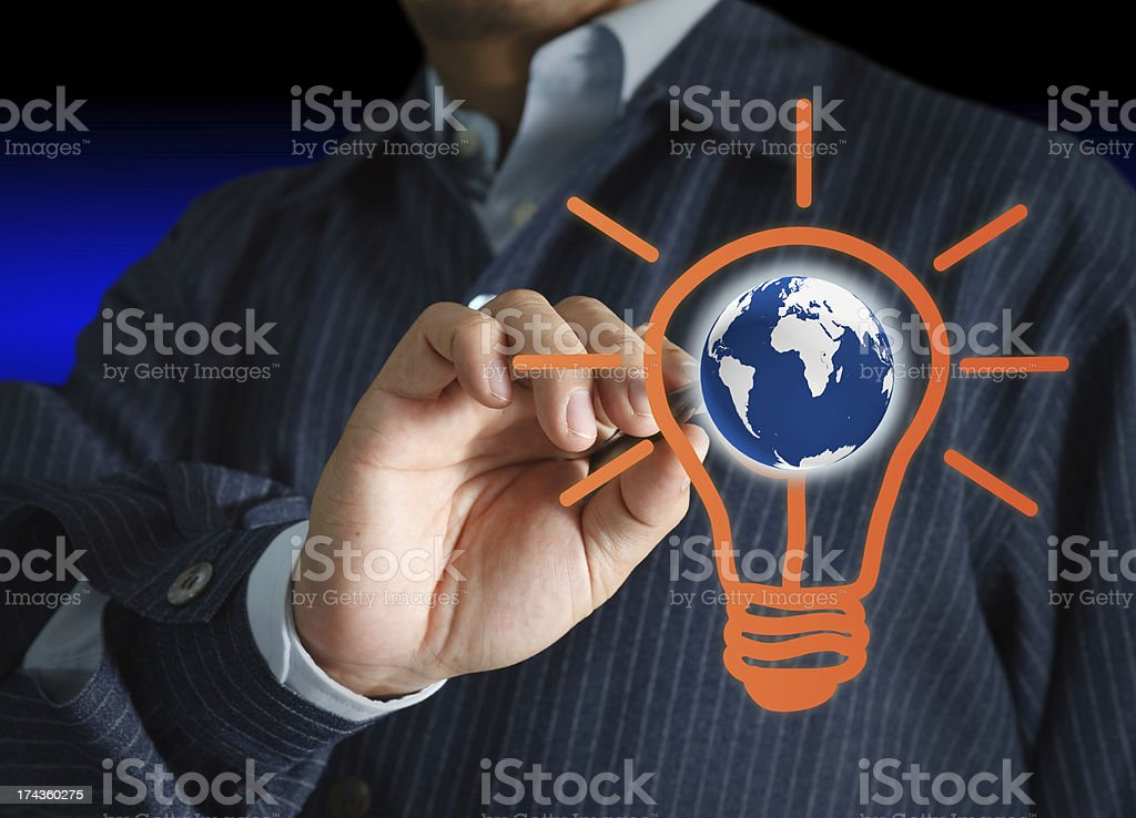 hand with a pen drawing light bulb and globe royalty-free stock photo