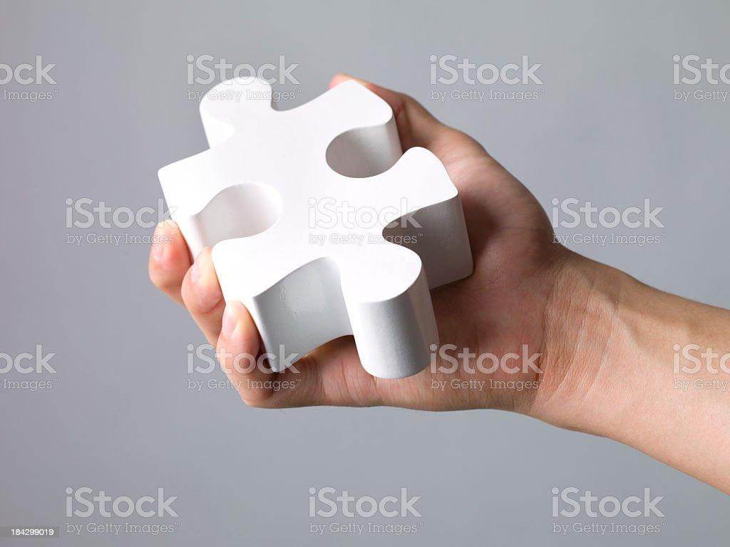 Hand with a puzzle stock photo