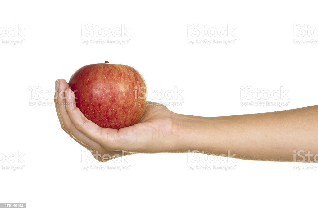Hand with a red apple royalty-free stock photo