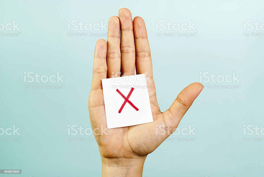 Hand with a red cross cancel concept stock photo