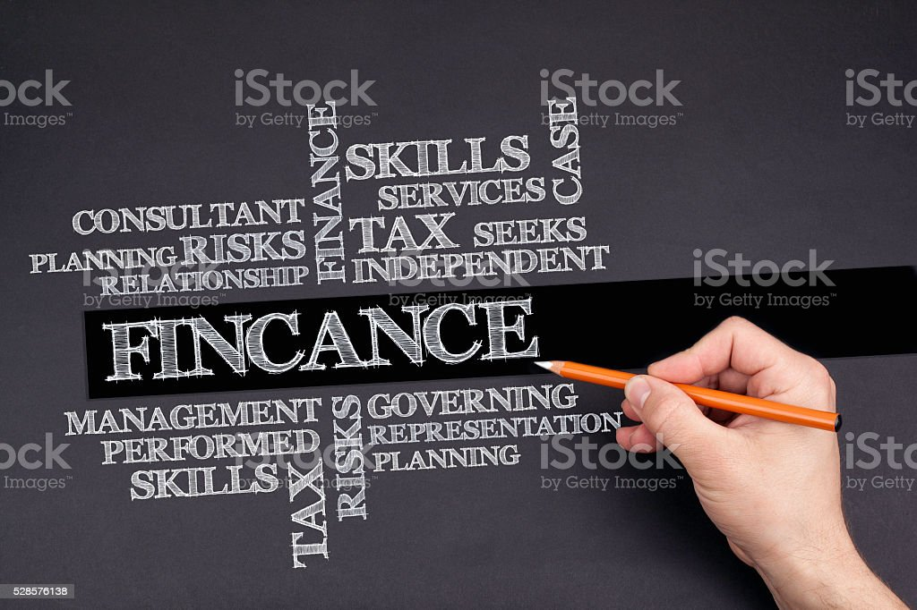 Hand with a white pencil writing: FINCANCE word cloud stock photo