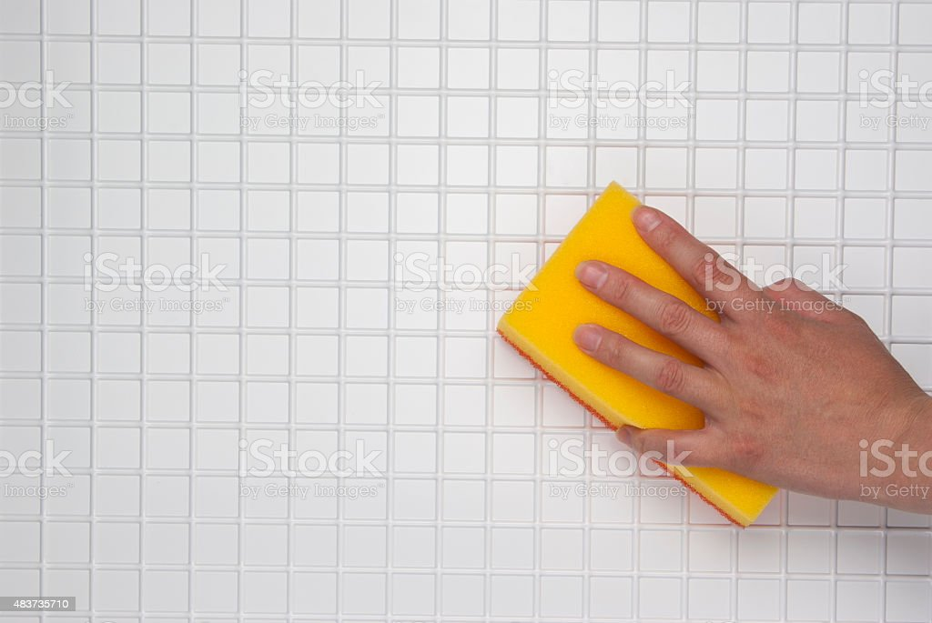 hand with a yellow sponge royalty-free stock photo