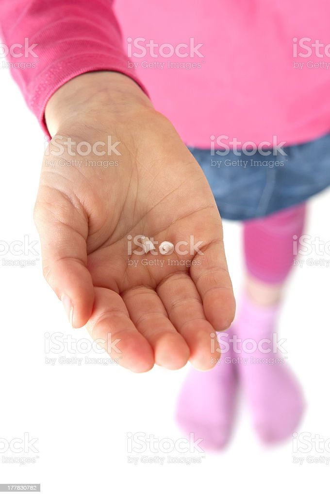 hand with baby teeth stock photo