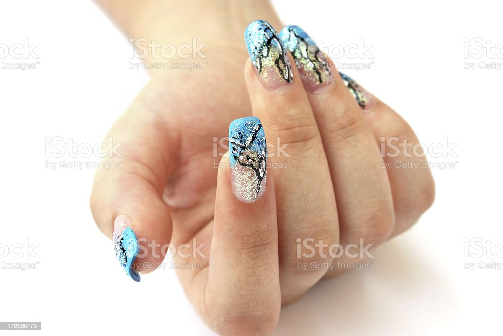 A hand with beautifully designed nail art royalty-free stock photo