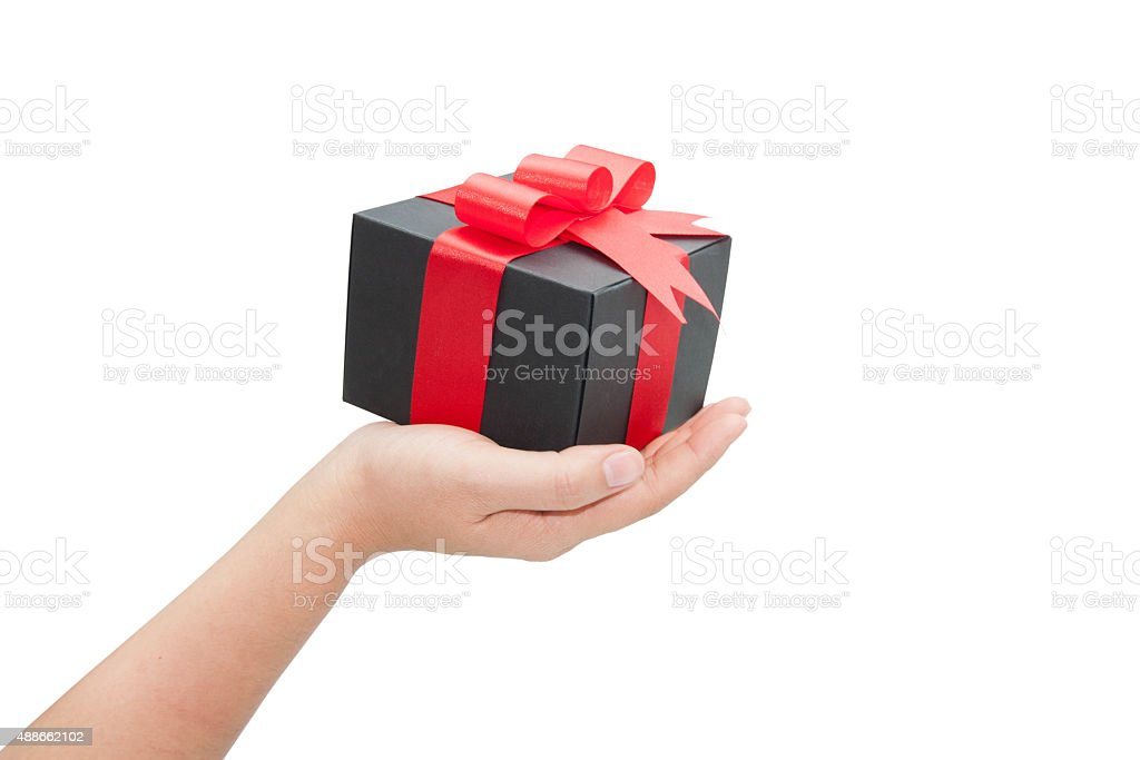 hand with black gift box on white background stock photo