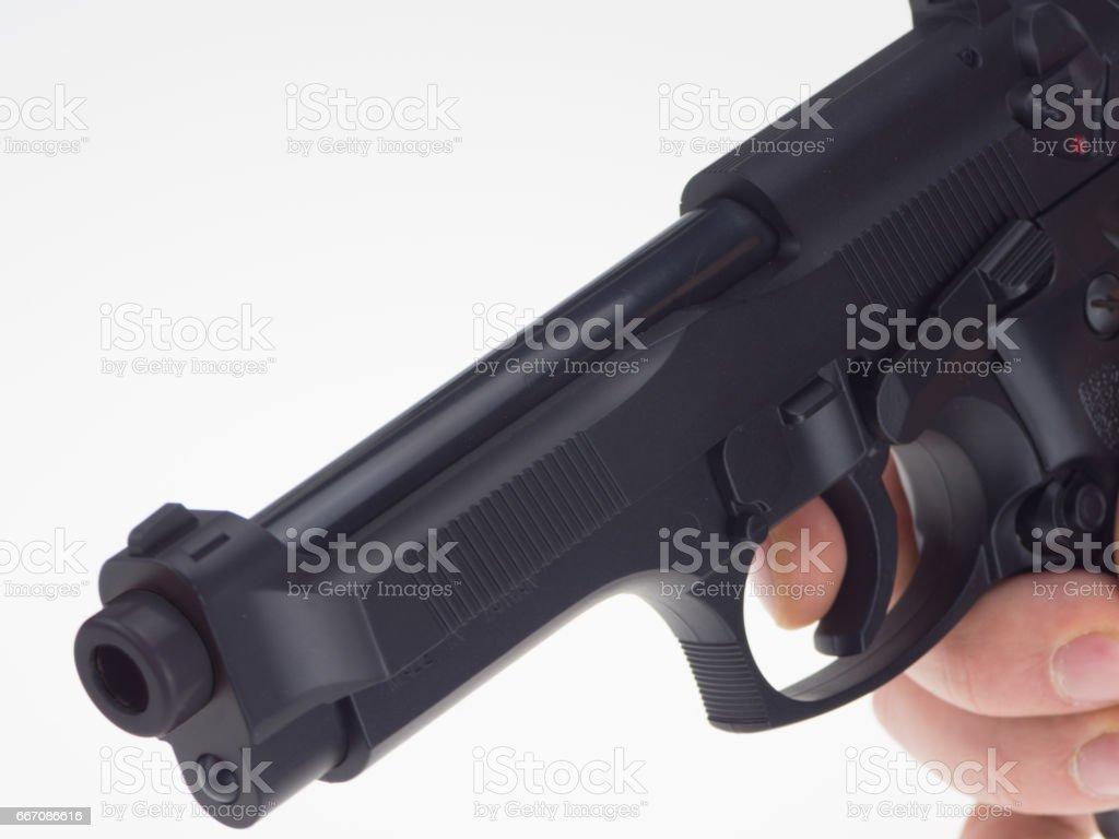 Hand with black gun stock photo