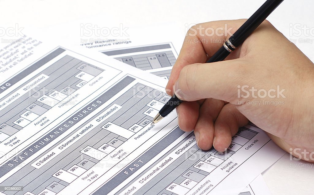 Hand with black pen royalty-free stock photo