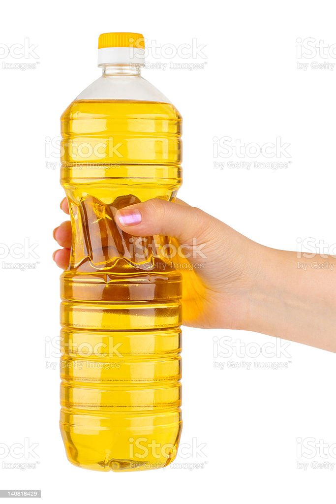 Hand with bottle of cooking oil royalty-free stock photo