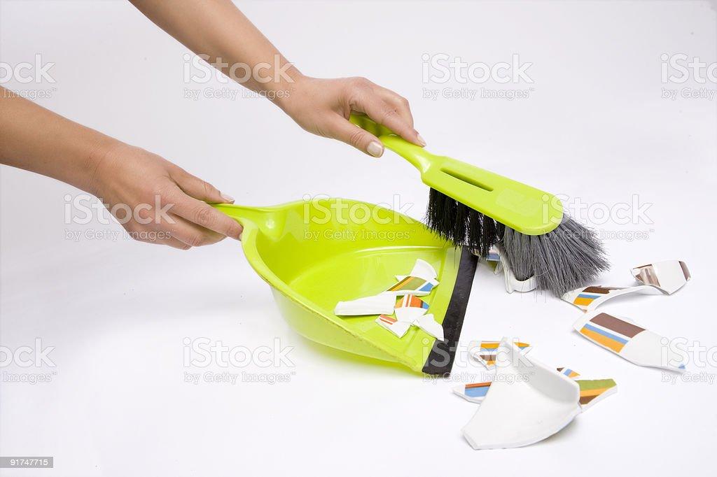 hand with broom stock photo