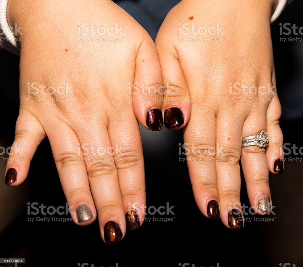 Hand with brown nails. royalty-free stock photo