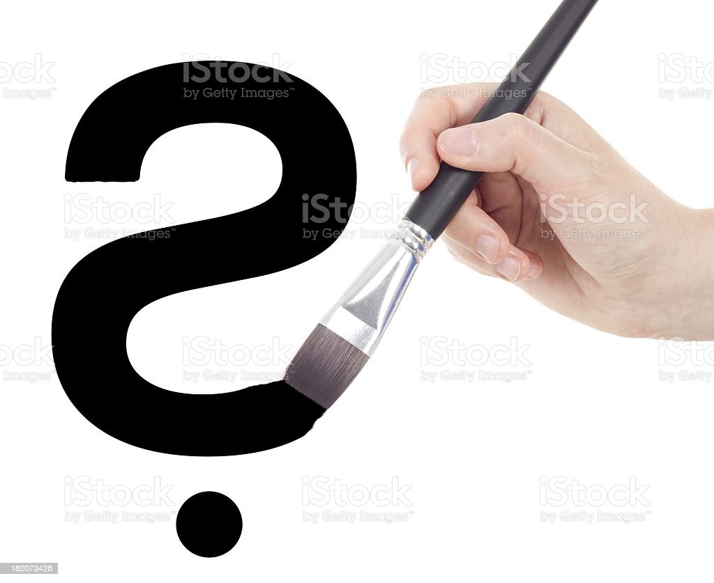 Hand with brush drawing question mark royalty-free stock photo