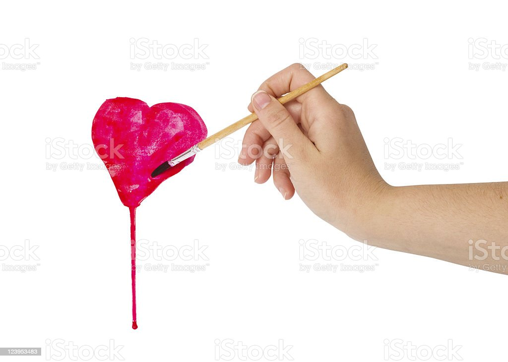 hand with brush drawing shape of heart royalty-free stock photo