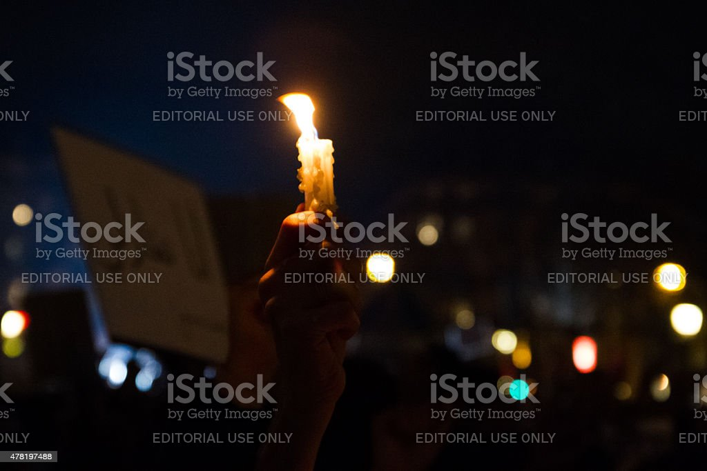 Hand with candle for Charlie Hebdo royalty-free stock photo