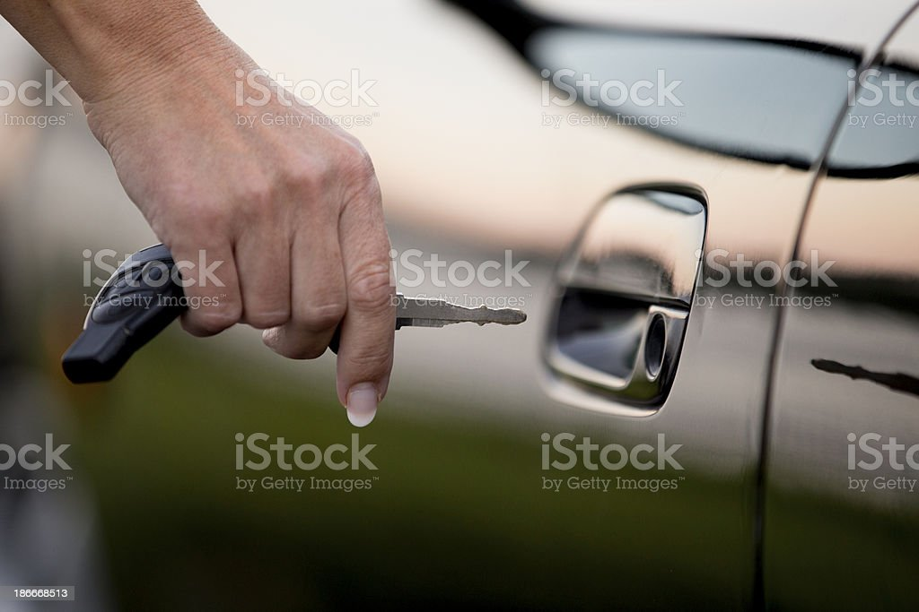 Hand with car key unlock car door royalty-free stock photo