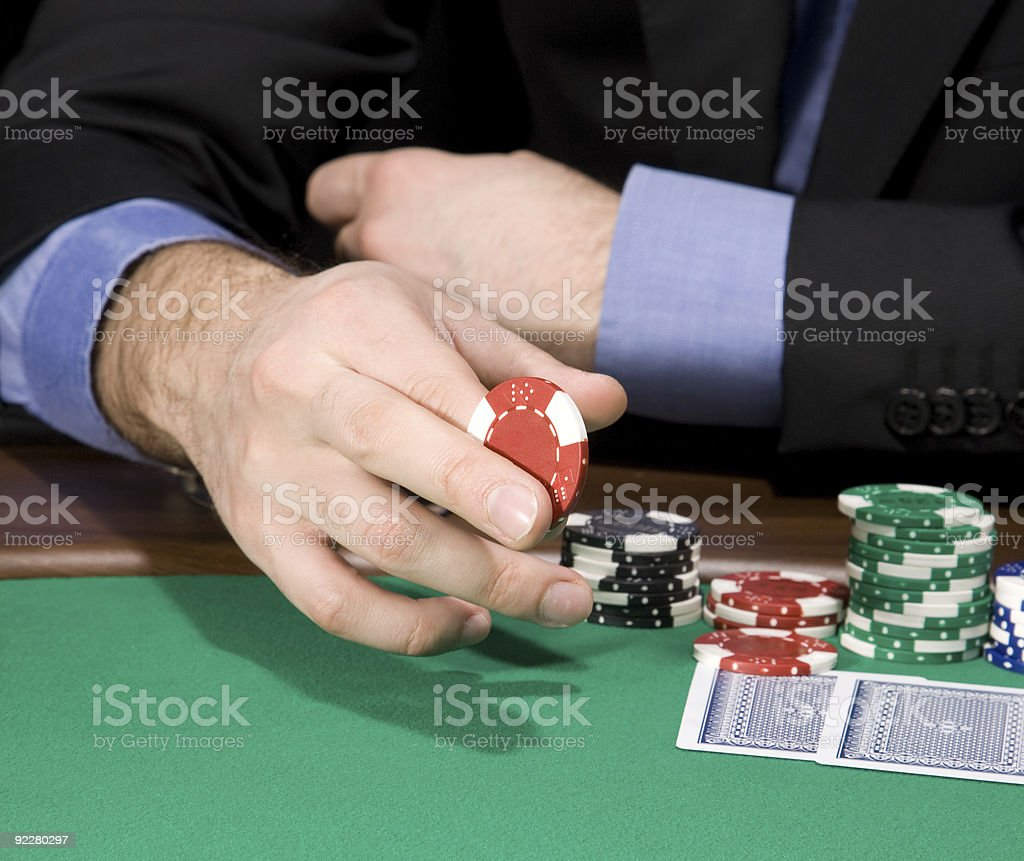 Hand with casino chip royalty-free stock photo