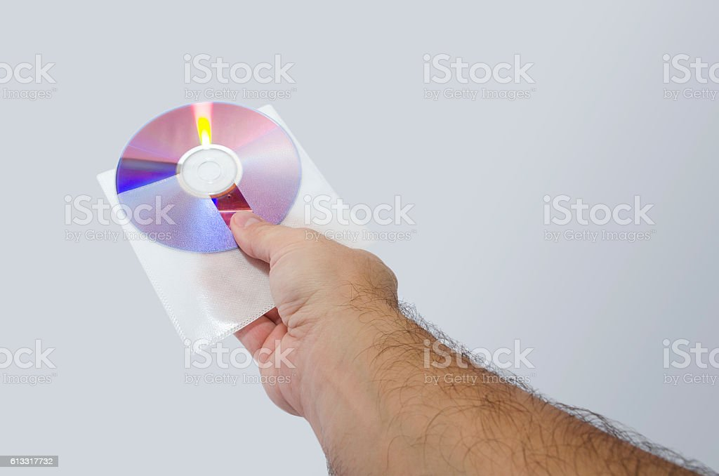 Hand with cd isolated stock photo
