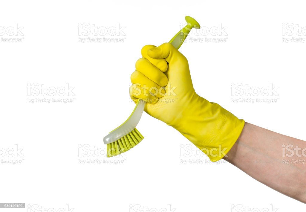 Hand with cleaning brush isolated on white background stock photo