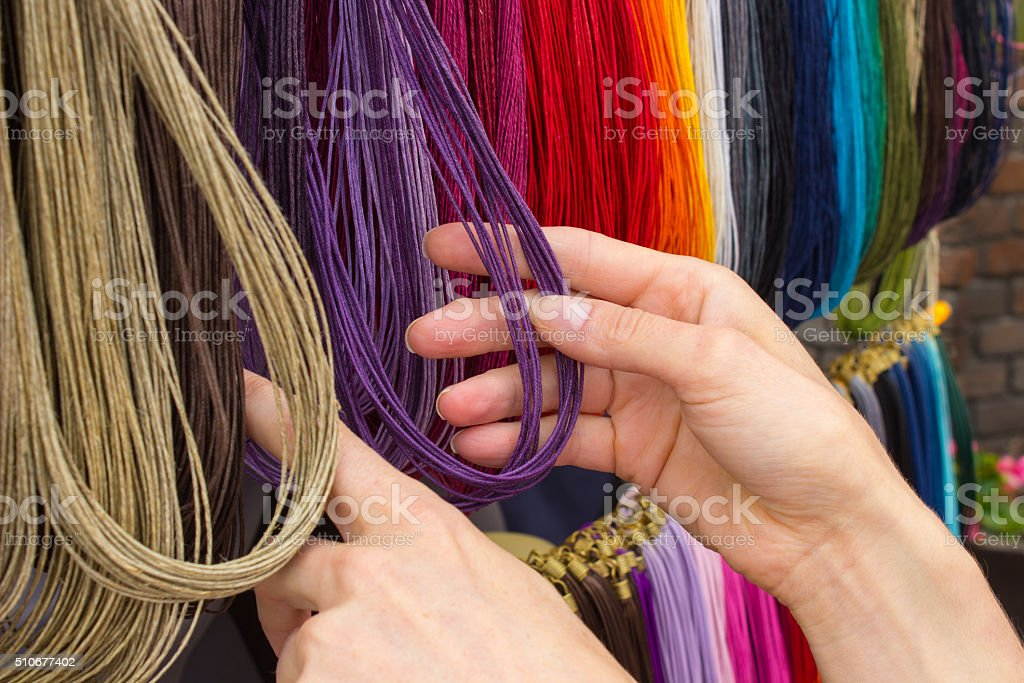 Hand with colorful necklace on stall at the bazaar stock photo