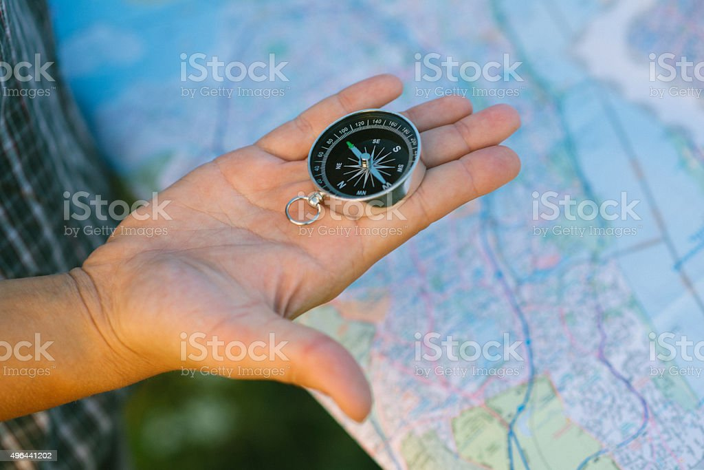 Hand with Compass stock photo