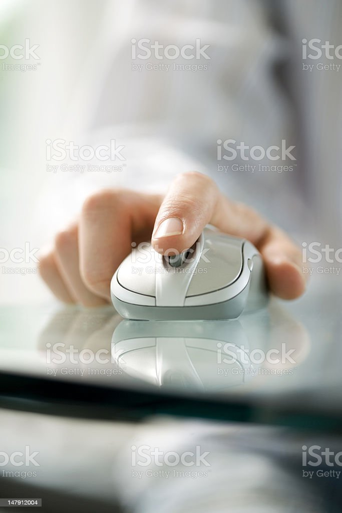 Hand with computer mouse stock photo