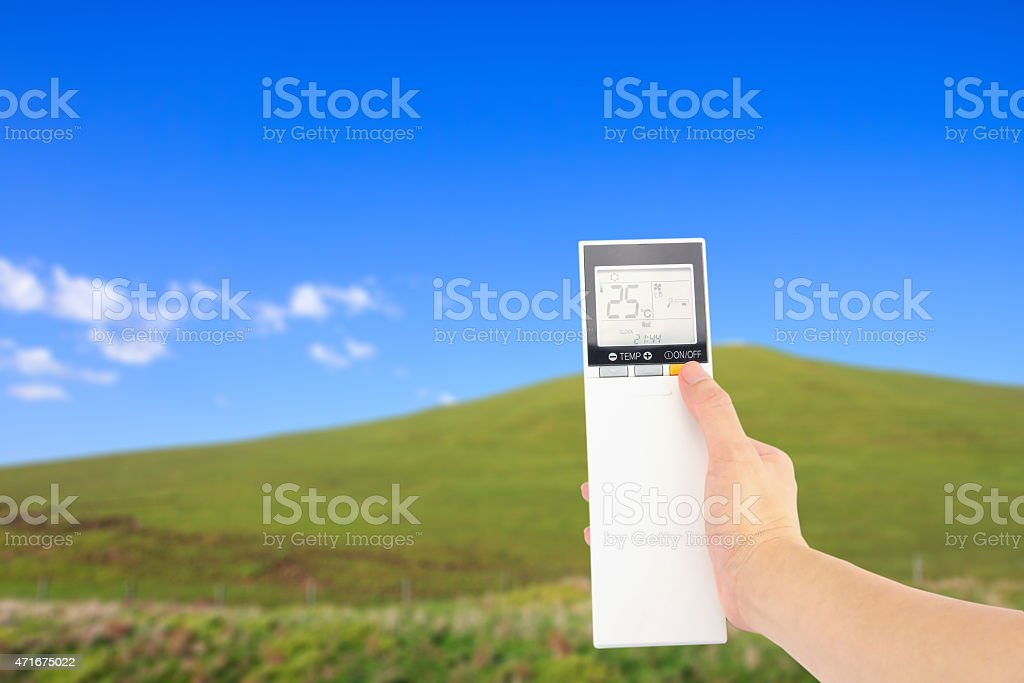 hand with control of the air conditioner controls the weather royalty-free stock photo