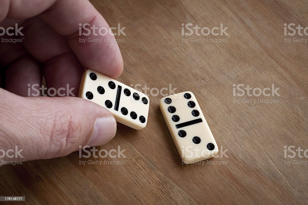 Hand with domino. royalty-free stock photo