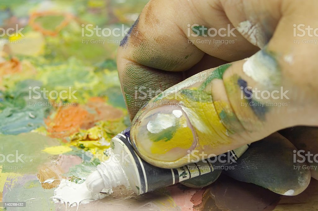 hand with dye tube stock photo