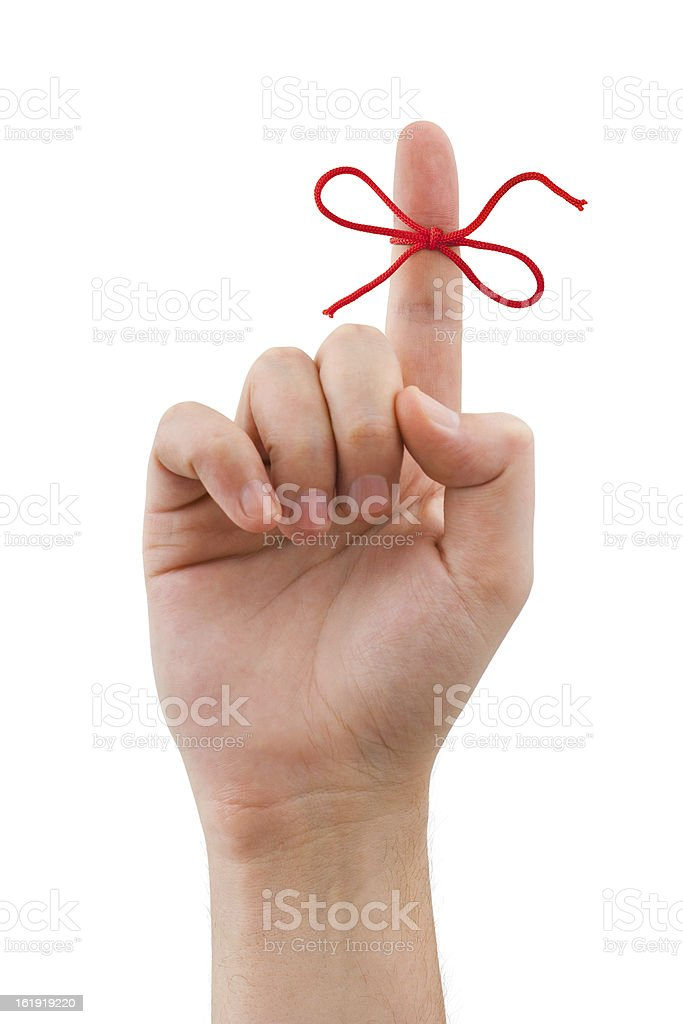 Hand with finger pointing up laced with red bow stock photo