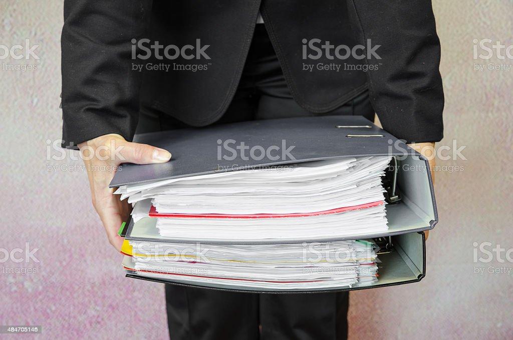 hand with folders stock photo