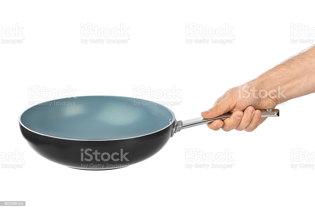 Hand with frying pan stock photo