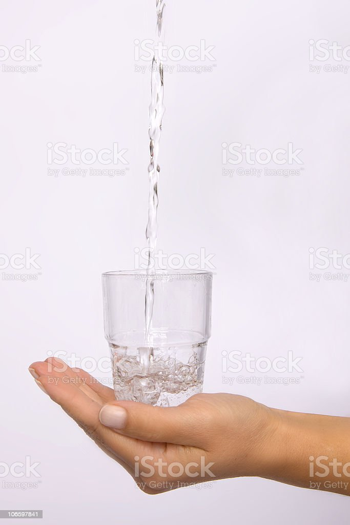 Hand with glass of water royalty-free stock photo