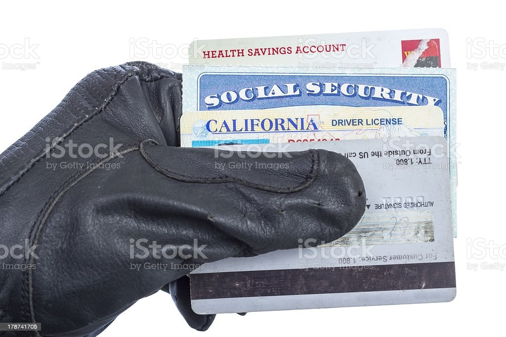Hand with glove holding identification documents stock photo