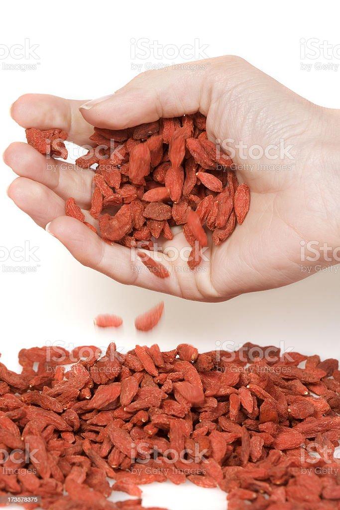 hand with goji berries royalty-free stock photo