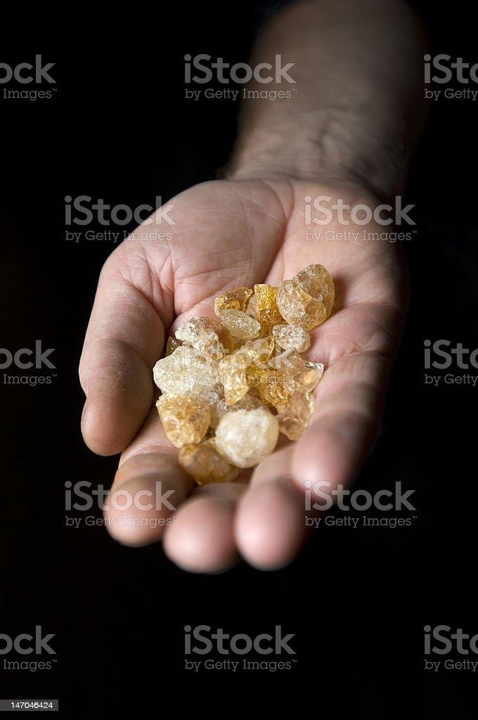 Hand with gum arabic stock photo