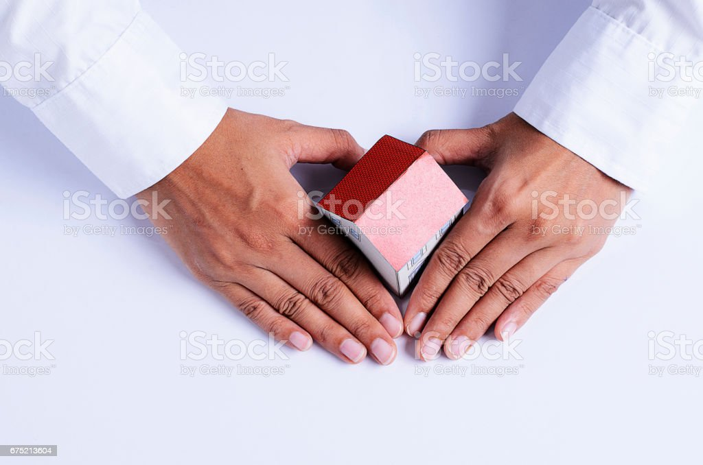 hand with heart shape and house paper for mortgage loans concept stock photo