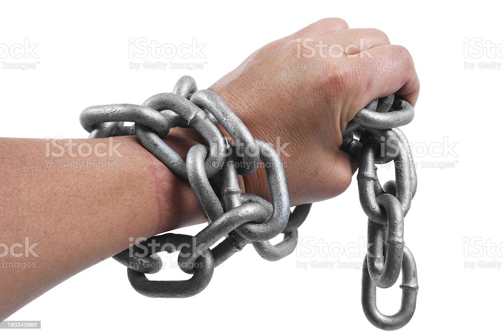 Hand With Heavy Chains stock photo