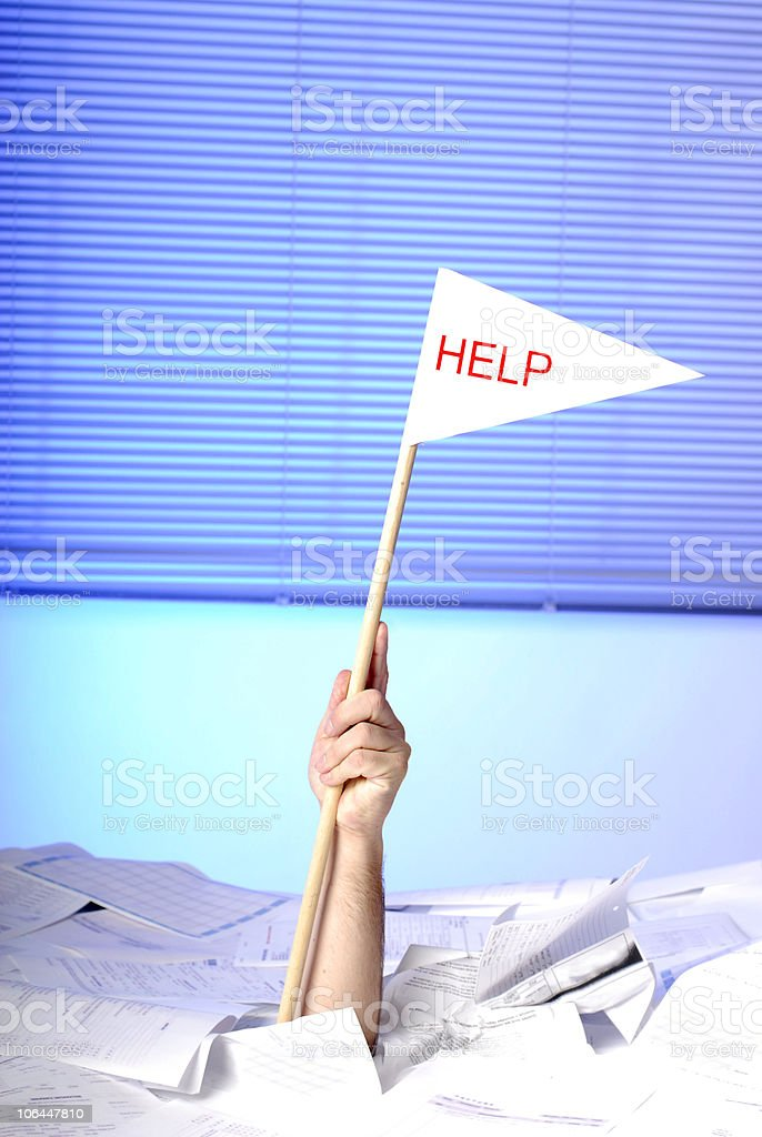 hand with help flag sticking out of papers royalty-free stock photo