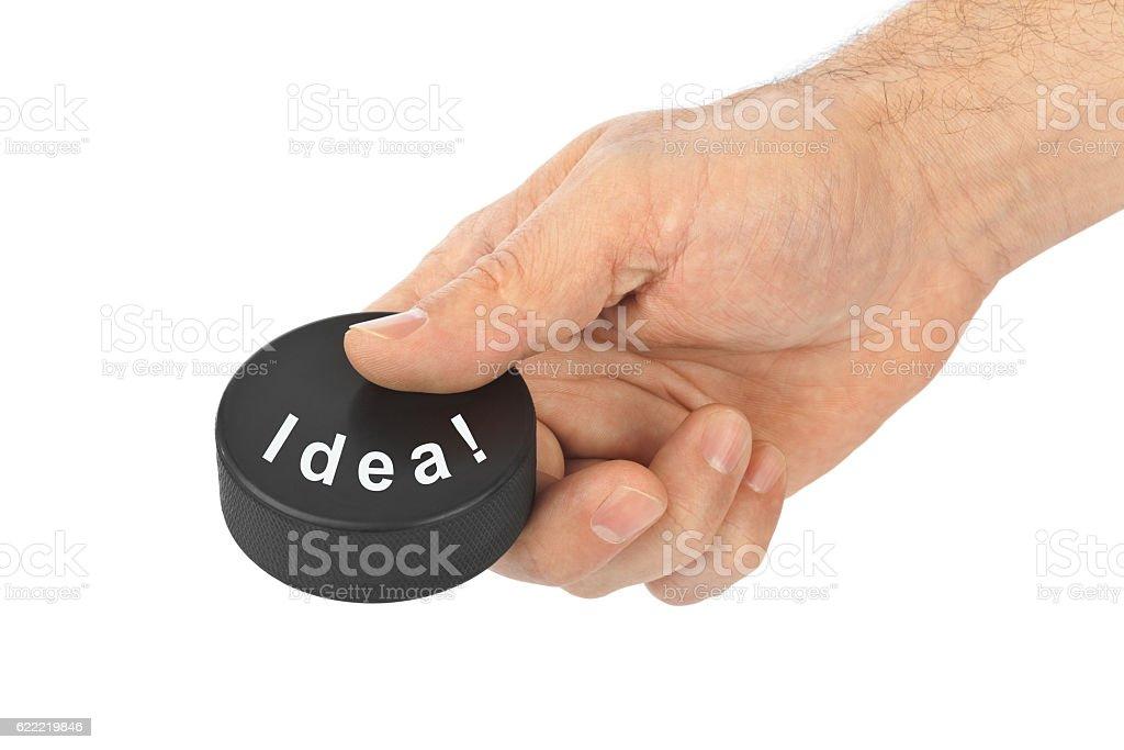 Hand with hockey puck Idea stock photo