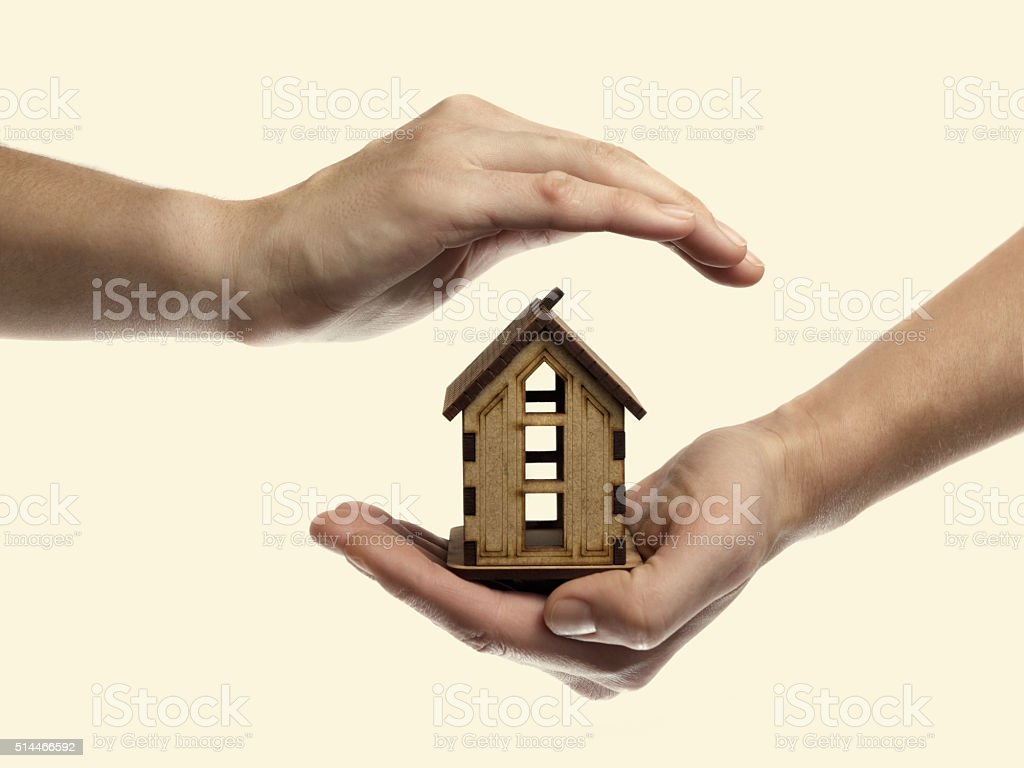 hand with house stock photo