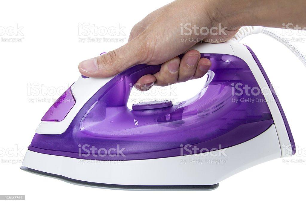 Hand with iron stock photo