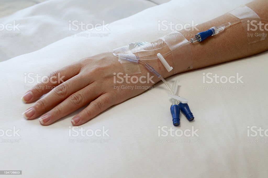 Hand with IV Drip royalty-free stock photo