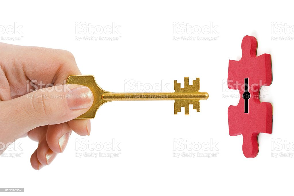 Hand with key and puzzle royalty-free stock photo