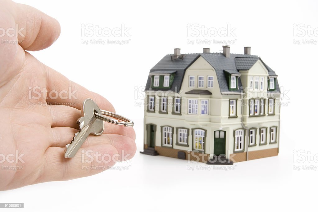 hand with key for house royalty-free stock photo