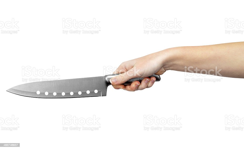 Hand with kitchen knife stock photo